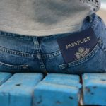 A U.S. Passport in the back pocket of someone's jeans.