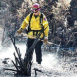 Firefighter mops up from wildfire