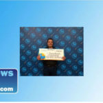Francisco Banuelos poses with a big prize check.