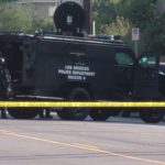 A SWAT vehicle at a barricade. Courtesy OnScene.TV