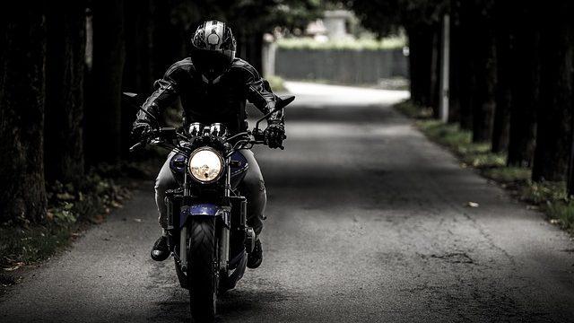 A man riding a motorcycle.
