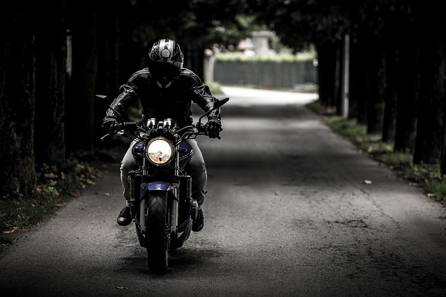 A man riding a motorcycle.