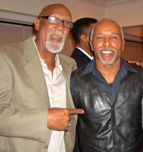 John Carlos (left), who was part of famous 1968 Mexico City Olympic podium protest, met up with Damien Leake at a Southern California Striders banquet.