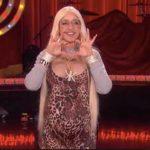 """Ellen DeGeneres dresses for Halloween excess as """"Karla"""" Kardashian."""