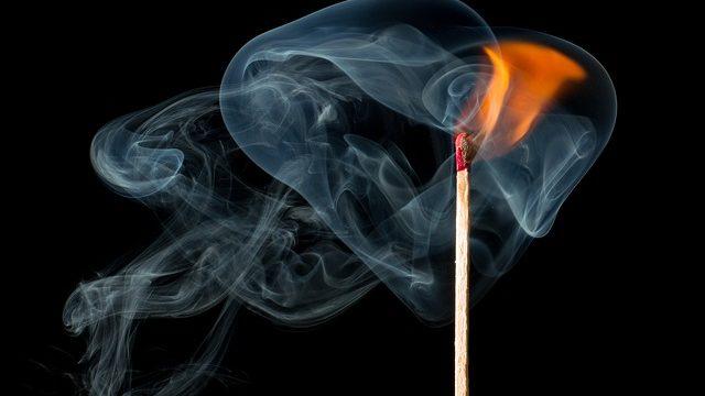 A burning match with smoke.