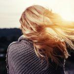 Wind blows a woman's hair.