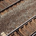 An overhead closeup photo of two sets of train tracks.