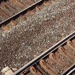 An overhead closeup photo of two sets of train tracks.