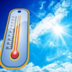 A temperature gauge in sunny skies.