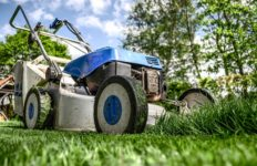 A lawnmower sits on grass.