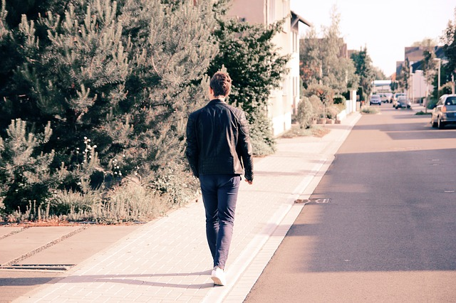 a pedestrian walks along a street.
