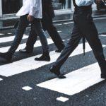 Pedestrians using a crosswalk.