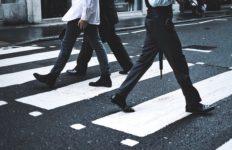 Pedestrians crossing a street.
