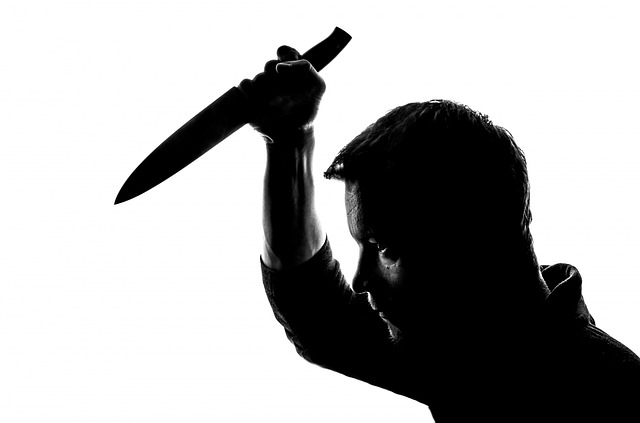 an example of a man raising a knife. Photo from Pixabay.