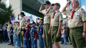 Boy Scouts saluting.