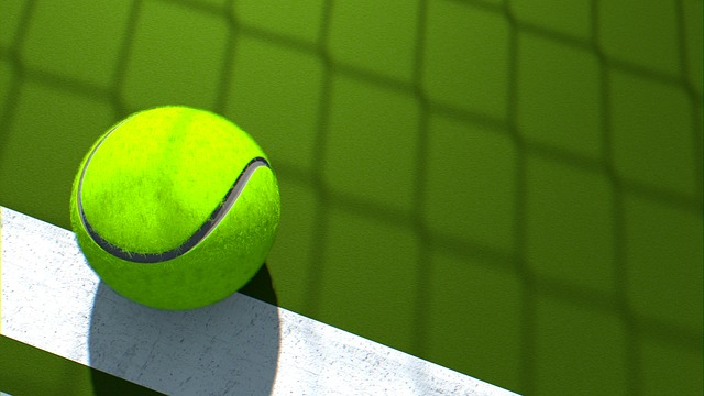 A tennis ball on a court. Photo from Pixabay.