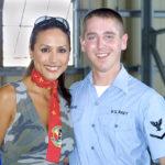 Leeann Tweeden poses with a fan on a USO tour at Yokota Air Base. Photo Public Domain.