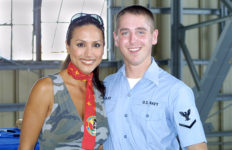Leeann Tweeden poses with a fan on a USO tour at Yokota Air Base. Photo Public Domain.