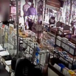 Two armed-robbery suspects entering a pharmacy in South Los Angeles. Video/photo from the Los Angeles Police Department.
