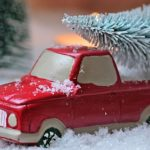 A toy truck and miniature Christmas trees. Photo from Pixabay.