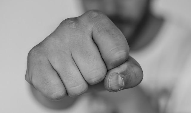 A man extends a fist.
