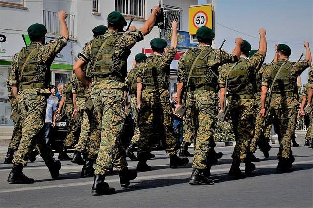 Soldiers marching in a parade. Photo from Pixabay.