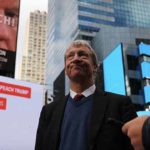 Tom Steyer with impeachment sign in Times Square.
