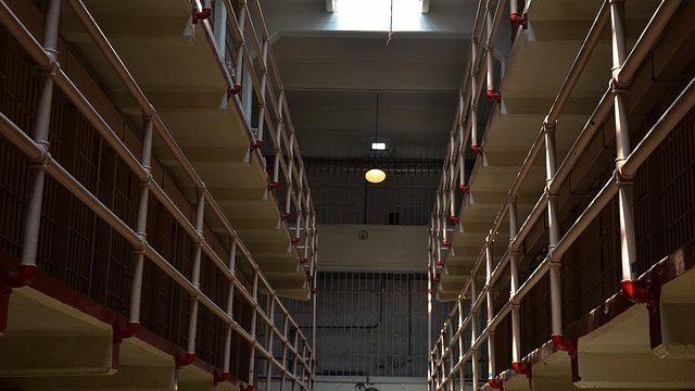 rows of prison cells. Photo from Pixabay.