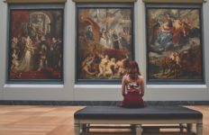 An example of a person enjoying art displayed in a museum. Photo from Pixabay.