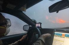 Deputy surveys Creek Fire flames
