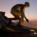 Surfing statue