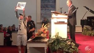 Tony Barbieri as Jake Byrd the Roy Moore supporter is kicked out of Senate candidate's rally in Alabama