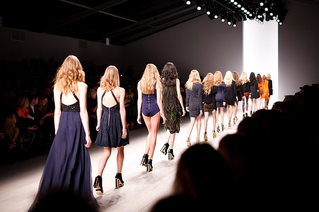 Models walk during a fashion show. Photo from Pixabay.