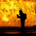 An example of a firefighter backlit by an inferno. Photo from Pixabay.