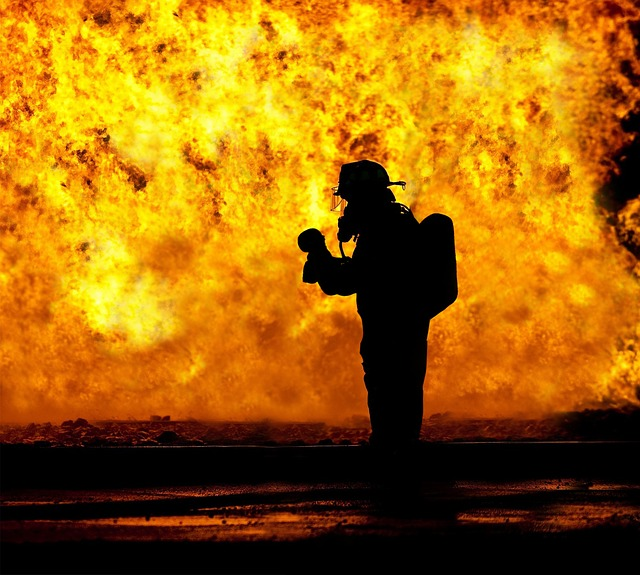 An example of a firefighter backlit by an inferno