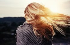 Windy weather blows a woman's hair. Photo from Pixabay.
