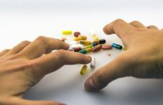 An example of someone frantically reaching for pills. Photo from Pixabay.