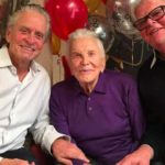 Kirk Douglas at birthday party with sons Michael and Joel.