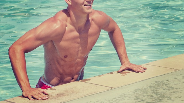 An example of a man enjoying a swimming pool. Photo from Pixabay.