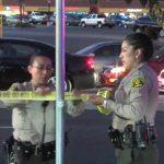 Deputies taping crime scene
