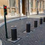 An example of traffic bollards, or barriers, separating roadway and pedestrian areas. Photo from Pixabay.