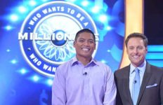 "David Tamayo (left) with ""Who Wants to be a Millionaire"" host Chris Harrison."