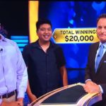 """David Tamayo (left) with his cousin Ryan and """"Millionaire"""" host Chris Harrison"""
