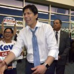 State Sen. Kevin de León greets Democrats lined up to vote for endorsements at the party's state convention in San Diego.