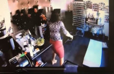 In this image provided by the Los Angeles Police Department a suspected carjacker is caught on a nail salon's video surveillance camera during an alleged attack on two women in Van Nuys. (LAPD/YouTube)