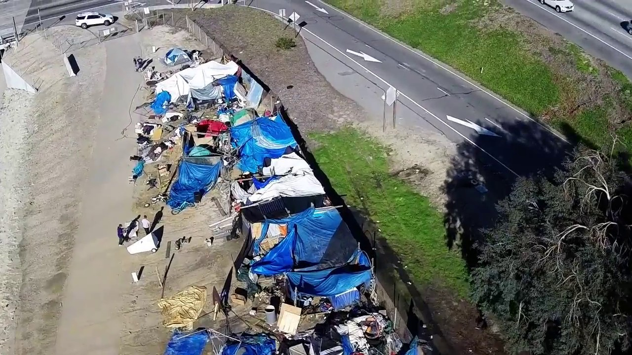 Judge Leads Lawyers, Advocates on Trip to Homeless Camp
