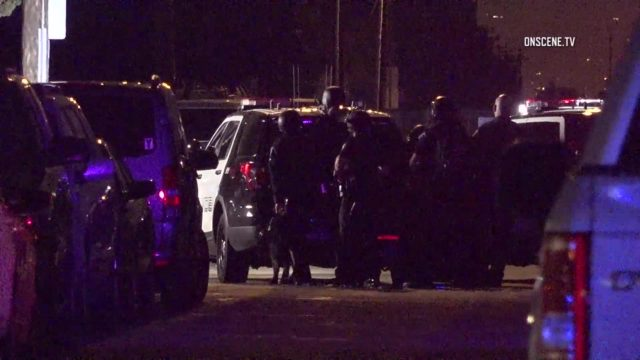 Armed suspect arrested after barricading himself inside garden grove cop car for Garden grove breaking news today