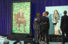 Barack and Michelle Obama study their official portraits at Washington unveiling.