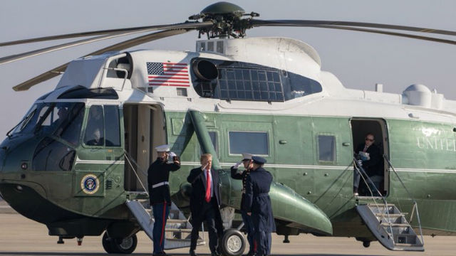 President Trump leaves helicopter