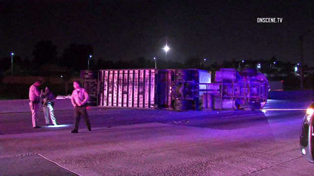 FedEx Truck Overturns On 210 Freeway, Trailer Lands On Gold Line Tracks